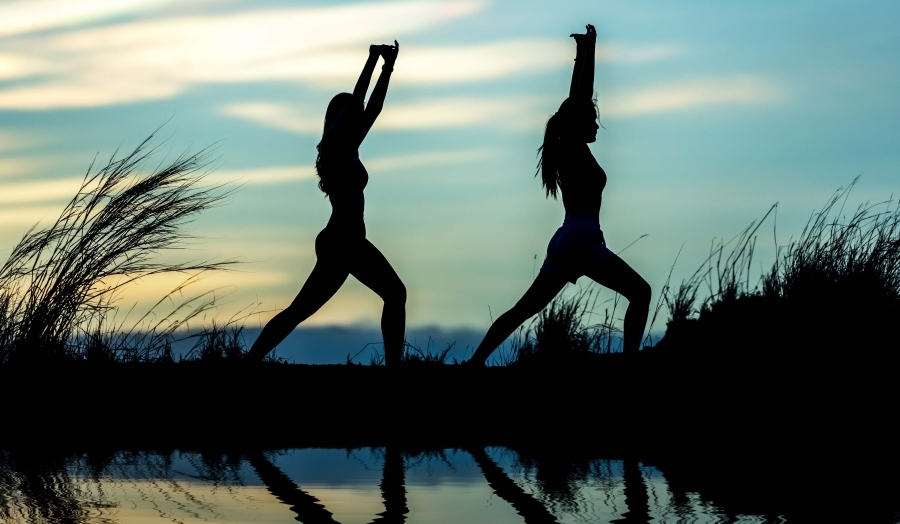 Outdoor Yoga Silhouettes of Two Women